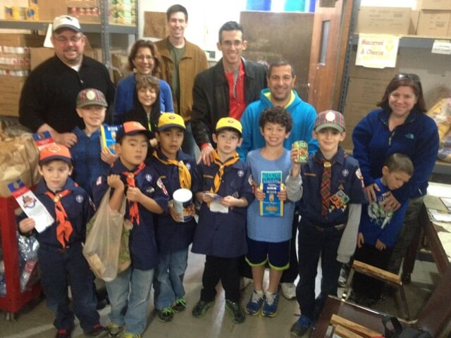 Scouts participating in our annual Scouting for Food drive.